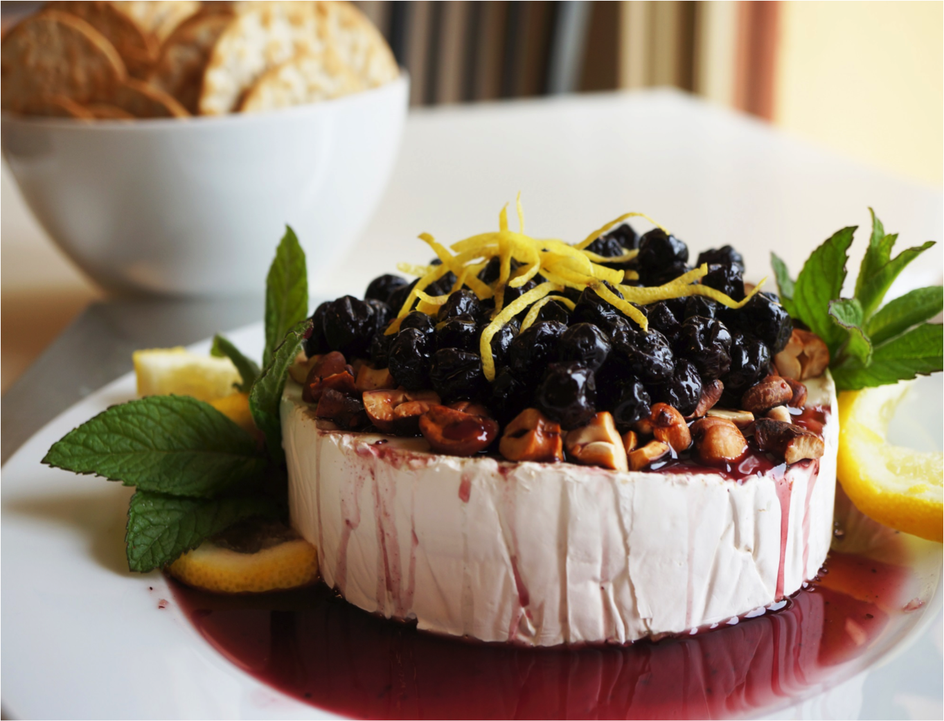 brie with lemon roasted cashews and blueberry sauce